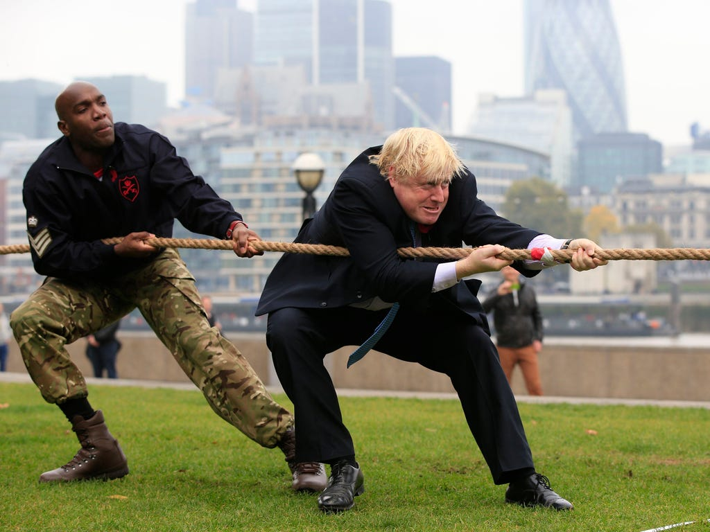 Mayor of London Boris Johnson participates in a tug of war contest with personnel from the Royal Navy, the Army and the Royal Air Force at the launch of London Poppy Day on Potters Field next to City Hall in London.