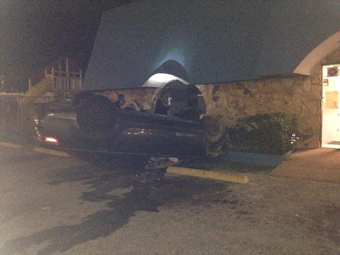 Two women were hurt overnight when their car landed upside down in the parking lot of the Achievement Center for Early Learning building on Busch Blvd.