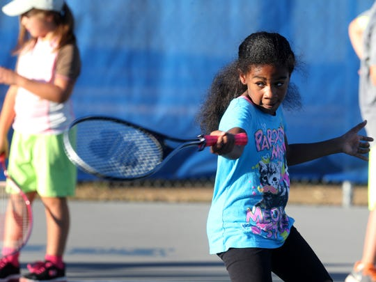Breana Wynn, 8, hits a tennis ball in 2015 during tennis camp led by MTSU tennis players and coaches.