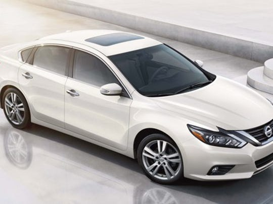 A white Nissan Altima midsize sedan, seen from above.