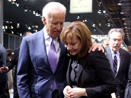 Vice President Joe Biden shares a moment with GM CEO