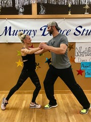 Kelli and Shawn Thompson practice their dance routine as they prep for the Dancing with the Michigan Stars event.