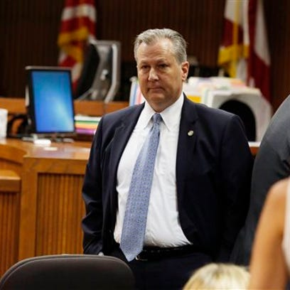 Alabama House Speaker Mike Hubbard stands in Judge