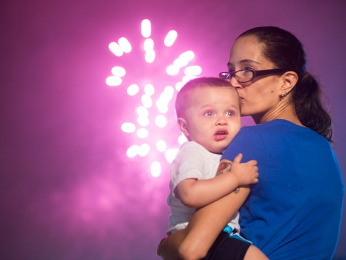 Felicia Benitez, right, comforts her son Da'Marion