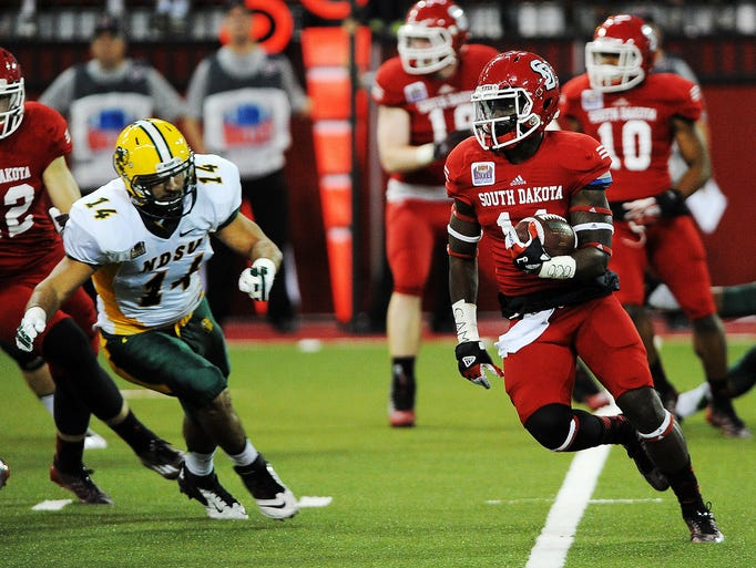 USD's Eric Shufford Jr. (11) rushes with the ball during the first half of a game against North Dakota State on Saturday, Oct. 25, 2014, at the DakotaDome in Vermillion, S.D. The Bison defeated the Coyotes 47 to 7. (Joe Ahlquist / Argus Leader)