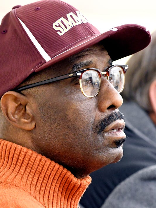 Simmons College President the Rev. Kevin Cosby watches a basketball game