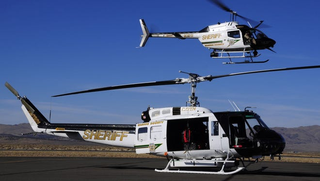 Two of the Washoe County Sheriff's Office's helicopters, including the Regional Aviation Enforcement Unit (RAVEN) Huey.