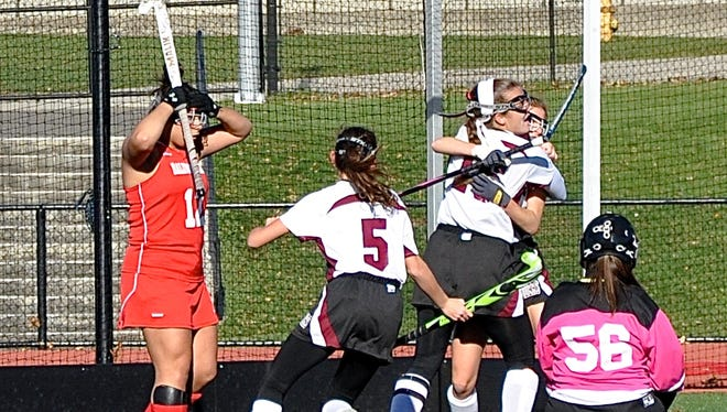 Jilly Mehlman embraces Erin Nicholas as Aliza Mehlman (5) races to them and Mariah Mancini (12) and Abigail Timmins look on as disbelief. Nicholas's double-overtime goal was the game-winner.