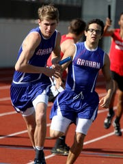 Graham's anchor Austin Bahl takes the baton from Isaiah Tirado in the 4x400 meter relay Saturday, March 18, 2017, at the PK Relays in Graham. Bahl, Tirado, Jonathan Sanchez and Wesley Martin finished in fourth with a time of 3:45.40.