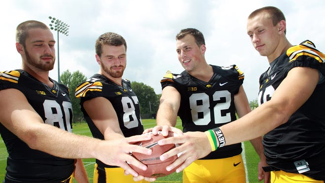 Iowa tight ends Henry Krieger Coble, from left, Jake Duzey, Ray Hamilton and George Kittle pose for a photo during Iowa football media day on Monday, Aug. 4, 2014.
