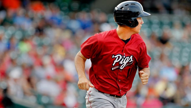 Southport native and Purdue baseball player Cameron Perkins (11) returns to Indianapolis as he plays right field for the Lehigh Valley IronPigs against the Indianapolis Indians at Victory Field in Indianapolis on Monday, July 7, 2014.