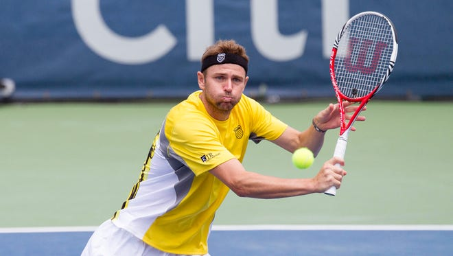 Mardy Fish volleys during the men's doubles final at William H.G. FitzGerald Tennis Center on Aug. 8, 2013.