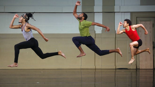 Left, Davente Gilreath, Wynton Rice and Andrew David O'Brien with Garth Fagan Dance rehearse at the company's studio.