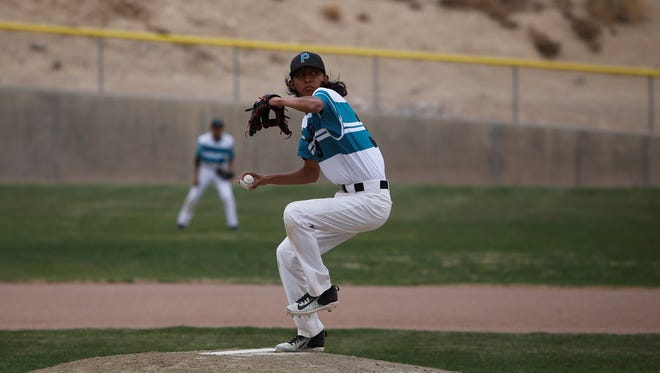 Navajo Prep's Trevor Smith fires a pitch against Thoreau during Thursday's District 1-4A game at Farmington Sports Complex. Visit daily-times.com to see the latest scores, photo galleries and video highlights.