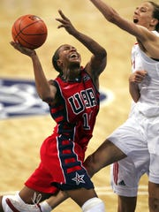 Tamika Catchings of the United States, left, drives to the basket in the fourth quarter past the defense of Russia's Tatiana Shchegoleva, during the 2004 Olympics. Catchings was selected to her fourth straight Olympic team on Wednesday.