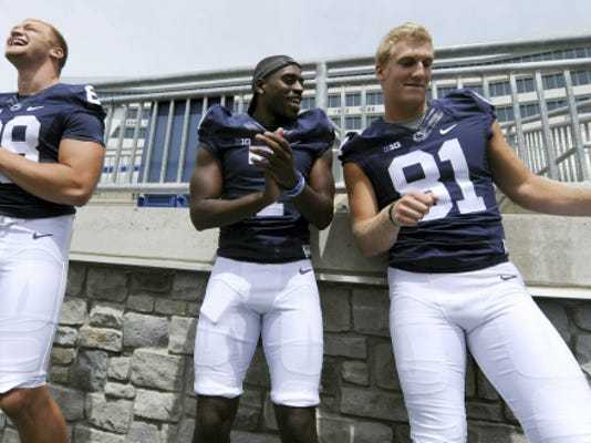 """Penn State football players, from left, Mike Gesicki, Geno Lewis and Adam Breneman show off their dance skills while being interviewed Thursday for media day in State College. The players have occasional impromptu dance-offs, which were the source for some friendly banter between the Lions on Thursday. """"You're only as good as your last performance,"""" Lewis told Breneman."""