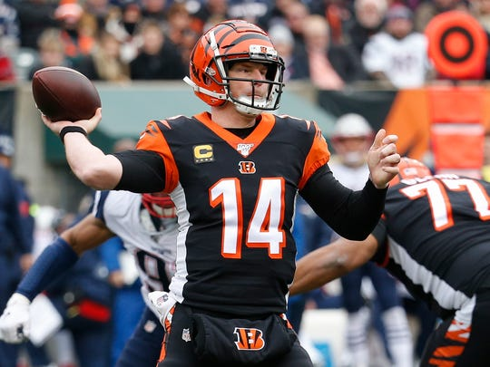 Cincinnati Bengals quarterback Andy Dalton (14) passes in the first half of an NFL football game against the New England Patriots, Sunday, Dec. 15, 2019, in Cincinnati. (AP Photo/Frank Victores)
