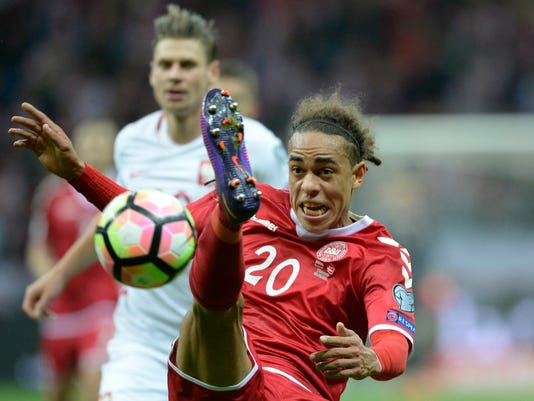 Denmark's Yussuf Poulsen is challenged by Poland's Lukasz Piszczek, behind, during their World Cup Group E qualifying soccer match at the National Stadium in Warsaw, Poland, Saturday, Oct. 8, 2016. (AP Photo/Alik Keplicz)