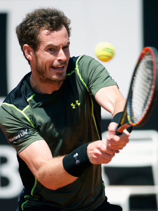 Andy Murray, of Britain, returns the ball to Jeremy Chardy, of France, during their match at the Italian Open tennis tournament, in Rome, Wednesday, May 13, 2015. (AP Photo/Andrew Medichini)