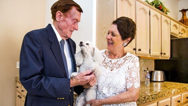 Jack Holder, 94, a World War II Navy veteran and survivor of Pearl Harbor, holds his dog Nicole at home in Sun Lakes with his fiance, Ruth Calabro, Tuesday, June 21, 2016.  Holder was scammed out of their life savings in a sweepstakes scam, but compassionate donors replaced all the money and then some by donating to a GoFundMe page.