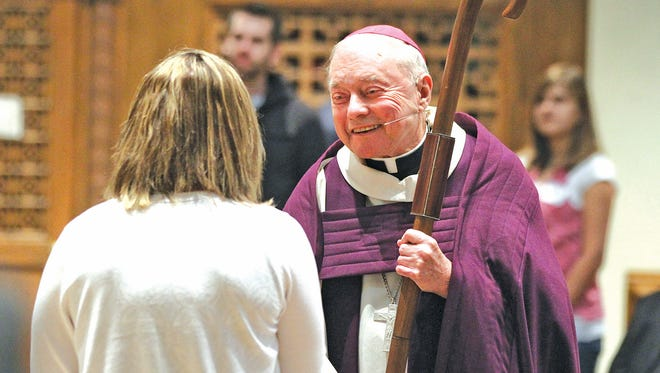Bishop John F. Kinney participates in the Rite of Election at the Cathedral of St. Mary in February 2012.