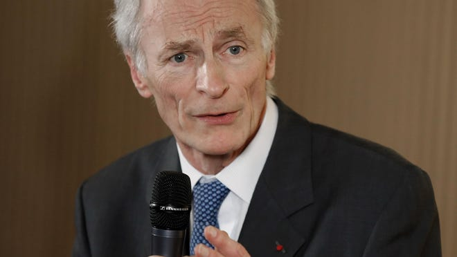 In this Jan. 24, 2019, file photo, Jean-Dominique Senard addresses the media after being appointed Renault chairman following a meeting of the board at Renault headquarters in Boulogne-Billancourt, outside Paris, France. Nissan Motor Co.'s board chose on Feb. 5, 2019, as a director Senard, who was recently appointed chairman at the Japanese automaker's alliance partner Renault SA.