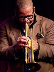 """Terence Blanchard has been so effective as the Detroit Symphony Orchestra's jazz creative director that what has traditionally been no more than a two-year appointment has morphed into a year-to-year evergreen deal that promises to keep him anchored here for the foreseeable future. """"If you're not careful, you might be stuck with me for life,"""" he says."""