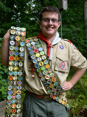 John Folwell IV with his 141 merit badges.