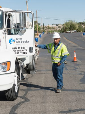 A Texas Gas Service employee worked in the El Paso area in May.  El Paso's natural gas utility is raising rates for a sixth consecutive year.