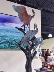 """Artist Geoffrey Smith's latest sculpture, """"Community Gathering,"""" which stands more than 6-feet, 6-inches tall and features life-size replicas of two ibis, a kingfisher, a rosette spoonbill, and snowy egret."""