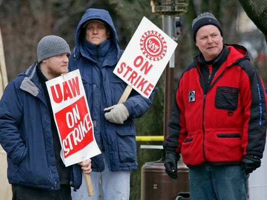 UAW Local 833 Striking Kohler workers stand on the