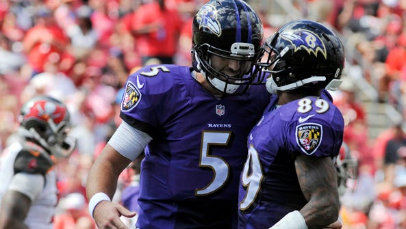 Ravens QB Joe Flacco (5) and WR Steve Smith missed