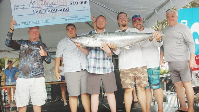 A.J. Proescher and his crew hold up their prize-winnning fish after winning the 2019 Ancient City Game Fish Association Kingfish Challenge. Their two-fish aggregate of 99.28 pounds was nearly 15 pounds ahead of second place.