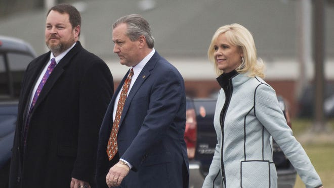 Lance Bell, left, newly announced lead lawyer for Mike Hubbard, walks with  Hubbard and his wife Susan Hubbard as they leave the Lee County Justice Center after a hearing on Friday, Jan. 8, 2016, in Opelika. The powerful Republican is now scheduled to go to trial March 28, a trial date that falls in the middle of the upcoming legislative session.