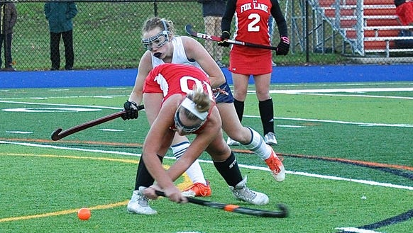 Fox Lane's Olivia Dey reverses the ball as Horace Greeley's