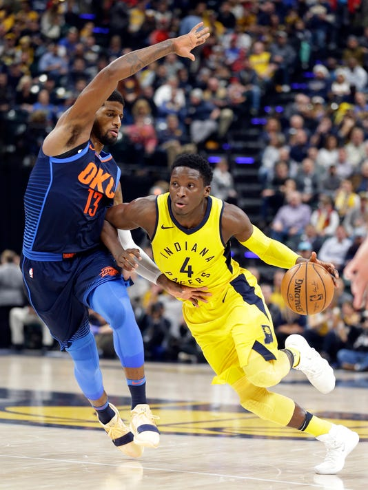 Indiana Pacers guard Victor Oladipo (4) drives on Oklahoma City Thunder forward Paul George (13) during the second half of an NBA basketball game in Indianapolis, Wednesday, Dec. 13, 2017. The Thunder defeated the Pacers 100-95. (AP Photo/Michael Conroy)