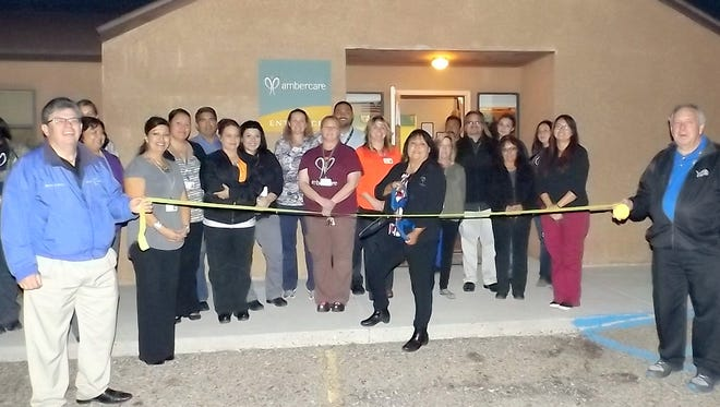 A ribbon cutting ceremony was held for Ambercare who moved their offices.