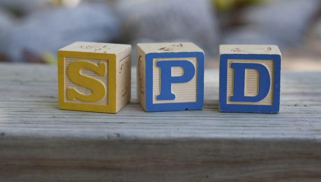 Blocks arranged to spell SPD, for Sensory Processing Disorder.