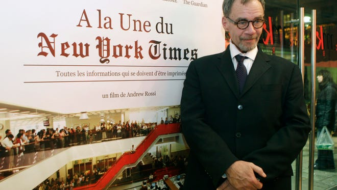 """New York Times journalist David Carr poses for a photograph as he arrives for the French premiere of the documentary """"Page One: A Year Inside The New York Times,"""" in Paris on Nov. 21, 2011. Carr  died on Feb. 12, 2015."""