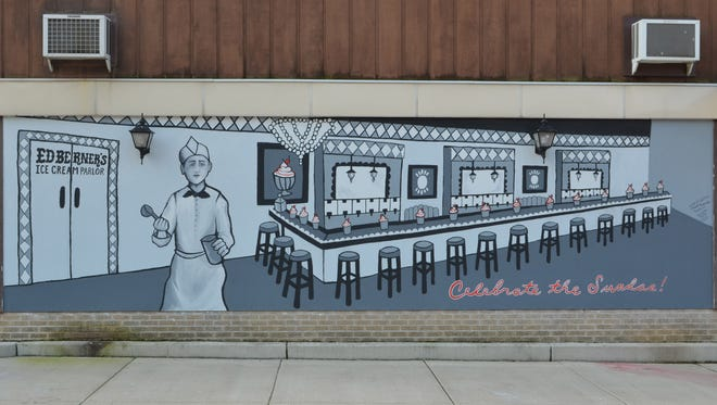 The newly painted mural outside Schroeder's in Two Rivers depicts Ed Berner, the Two Rivers native responsible for the invention of the ice cream sundae, in his original store.