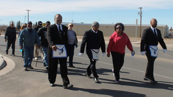 In this 2016 file photo, members of the Prince Hall Mason Lodge in Alamogordo march in the Martin Luther King Jr. Day memorial march Monday afternoon.