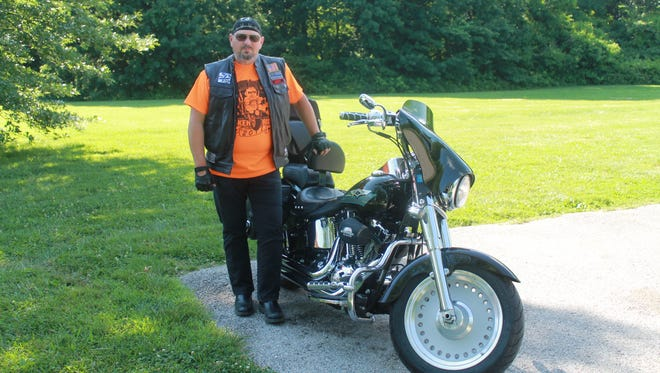 Clark Parmley and his 2008 Harley Davidson Fatboy will participate in the Cruisin' for Cribs motorcycle poker run Saturday.