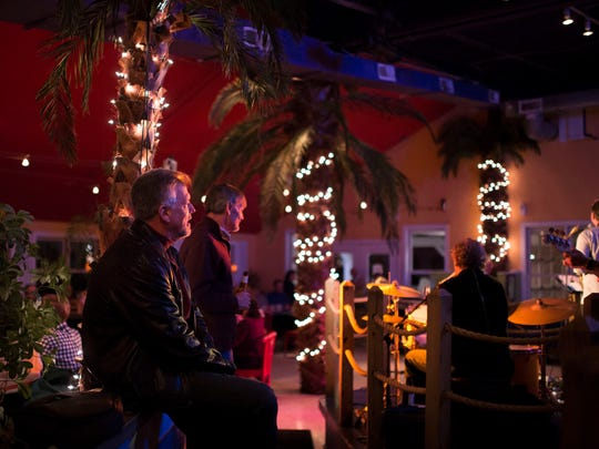 Guests watch The Funsters perform as the ALPHA ALPHA Sorority Annual Fundraiser Dance takes place at Mango Mike's Saturday, Feb. 28 in Bethany Beach.