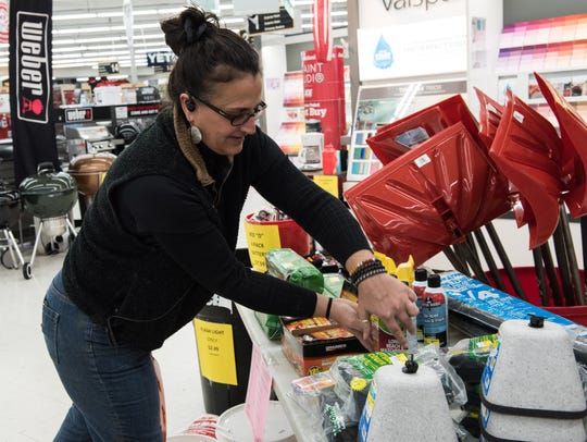 Sales Manager, Tonia Moore, stocks a winter supply