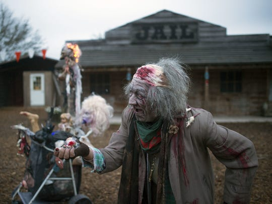 Jim Snyder hands out candy at Screams at the Beach in Georgetown, which opens Sept. 29.