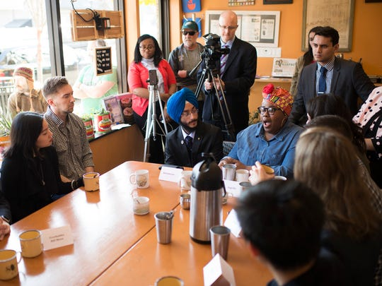 Ingelle Gonzalez, from right, and Karanveer Singh Pannu participate in a discussion with Congressman Donald Norcross during 'Coffee with a Congressman' inside The Square Meal Tuesday, Feb. 20, 2018 in Oaklyn, N.J.