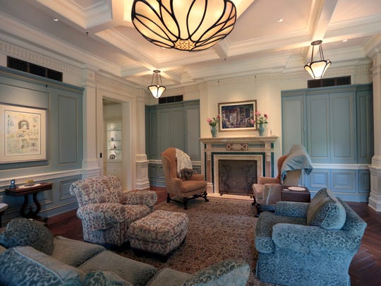Wood molding is beyond lavish: In the living room, dining room and sitting room, the elaborate wainscot, window frames, door frames and crown molding cover more of the walls than the what is left plain.