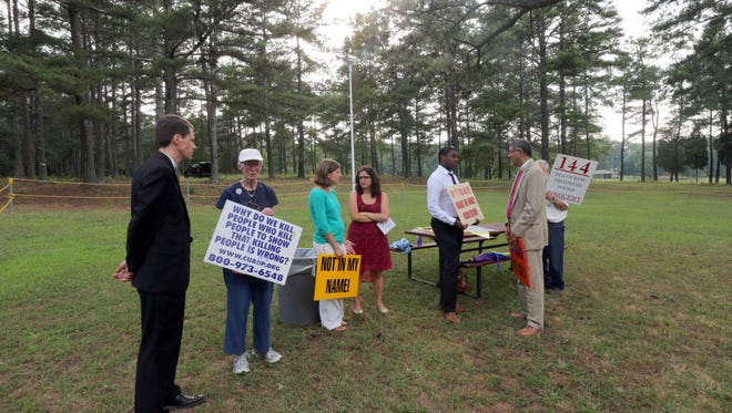 Death-penalty opponents gather in Jackson, Ga., on June 17 outside the prison where Marcus Wellons would be executed that night.