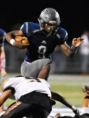 Dallastown's Nyzair Smith gains some yardage while