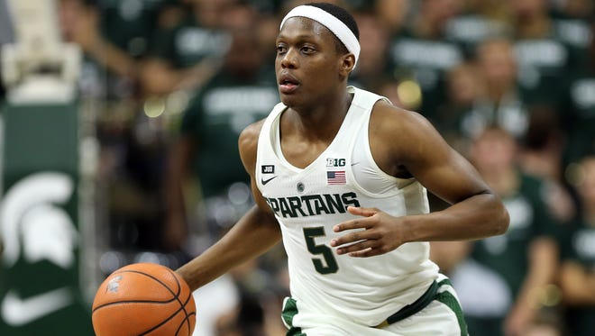 Nov 10, 2017; East Lansing, MI, USA; Michigan State Spartans guard Cassius Winston (5) brings the ball up the court against the North Florida Ospreys during the second half of a game at Jack Breslin Student Events Center.
